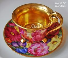 TEACUP:  VIBRANT FLORAL TEACUP AND SAUCER - TEACUP LINED IN GOLD