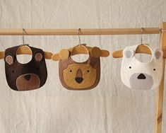 Set of 3 handmade animal bibs including bear, lion and polar bear. These bibs have been designed and handmade by me using premium washed linen. The bibs are intricately cut and stitched together with a tight zigzag stitch prevent fraying. The bibs are then hand finished with embroidered