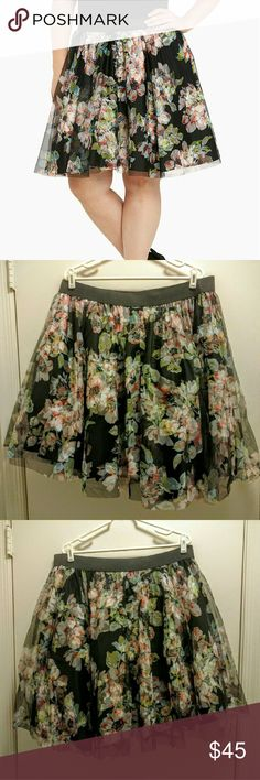 """Torrid - Floral print tulle skirt New with tags. Torrid - size 1. Very cute, full tulle skirt with a flirty and feminine floral pattern.   Measures 21"""" from center front  Polyester/rayon Hand wash cold, line dry torrid Skirts"""