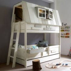 Creative bunk bed idea for a boy's or girl's room. Perfect for a kid who loves to sleep in a cozy spot.