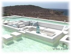 Villa in Mykonos with a sunken living room... sunken into the rooftop pool.