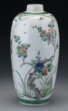 """Chinese Kangxi famille verte porcelain jar depicting butterflies in a rocky garden, within two reserved cartouches. 7.25""""H, Circa - 1661-1722."""