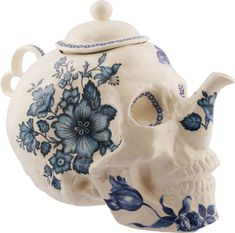 Tea, anyone?   an antique looking, teapot in the shape of a skull, with beautiful blue floral patterns.  I LOVE IT