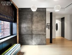 Those doors!  Sara Story Transforms a TriBeCa Loft.  At a TriBeCa loft by Dirk Denison Architects and Sara Story Design, a door clad in patinated zinc slides out to partially enclose the den. Photography by Eric Laignel.