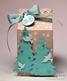 Beautiful placeholder or gift box made with the Memory Box Buttermilk Carton Die, Frosted Spruce and Frosted Pine Dies, Small Flock of Doves and Advent Calendar Die set. Created by Deborah Nolan. Christmas Favors, 3d Christmas, Christmas Wrapping, Xmas Gifts, Christmas Ornaments, Milk Box, Mini Milk, Eid Boxes, Milk Carton Crafts