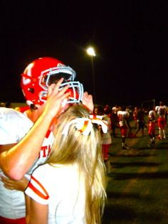 cheerleader and football player<3
