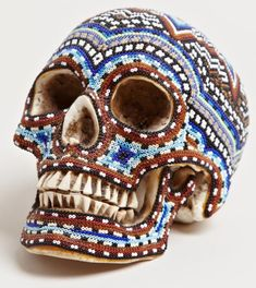 """patternbank: """"'Our Exquisite Corpse' teamed up with the Huichol people of western Mexico to produce these intricately beaded skulls. Each of the heavily beaded pieces has been decorated by various artists from the Huichol, using traditional symbols and designs arranged within the patterns, making every skull a completely unique piece of art."""""""