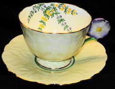 AYNSLEY ENGLAND FLOWER HANDLE TEA CUP AND SAUCER