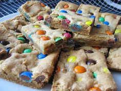 M & M Bars - 1 box yellow cake mix, 2 eggs slightly beaten, 1/4 c water mix together and fold in 1 cup of M & Ms.  Bake for 30 min. @ 350