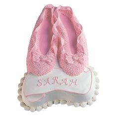 Ballet Slippers Cake  - Treat a tiny dancer to a diva-worthy cake. Use icings tinted with her favorite colors to add distinctive and personalized dimension to a Ballet Slippers Pan cake.