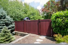 The New Face of American Landscaping. Wood grain PVC vinyl fence from Illusions Vinyl Fence. #backyardideas #vinylfence #illusionsfence #colorfence