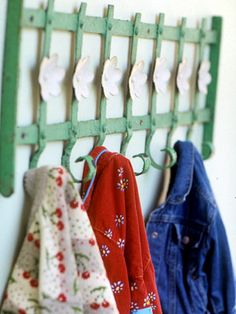 Repurpose Idea~ Mount a section of iron fencing on the wall as a coat rack. The curled ends of this fence section are just right for holding coats, towels, robes, or leashes.