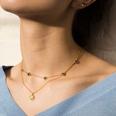 Bask in the sunshine wearing a curated layering of necklaces.