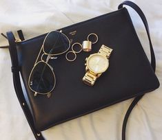 b1b8f14a61d2 Celine trio pouch, ray-ban aviators, golden rings and watch. Clutch Wallet