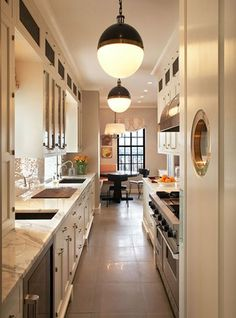 Galley Kitchen Inspirations & Functional Considerations Those are come cool lights