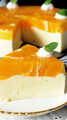 Mousse Cake When it warms up, you need a sweet treat to cool down—and a citrusy, fluffy no-bake cake is just the thing.When it warms up, you need a sweet treat to cool down—and a citrusy, fluffy no-bake cake is just the thing. Jello Recipes, Sweets Recipes, Cheesecake Recipes, Fancy Desserts, Just Desserts, Delicious Desserts, Orange Mousse, Cupcake Cakes, Food Cakes