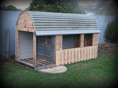 Look what my Dad made with an old garage door,an old wooden cable drum and free Pallets. This playhouse was acheived with only the cost of nails and screws.