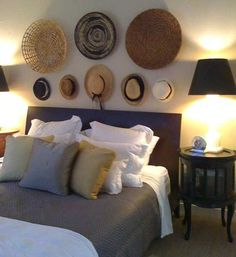 bedroom wall decorating with small hats and large wicker plates