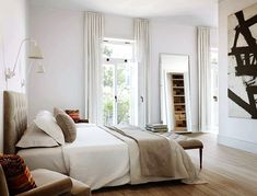 Chic Stockholm residences | NordicDesignlove the neutrals and sunlight and yes -pops of color, and a door that goes outside!