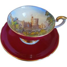 Antique Aynsley China Windsor Castle Burgundy Hand Painted Pedestal Cup And Saucer, Gold Trim, Artist Signed, D. Jones, Circa 1920-1939 - First half of the 20th Century English bone china teacup tea cup.