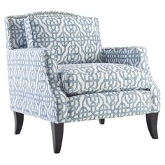 Bring eye-catching style to your living room or master suite with this bold arm chair, showcasing trellis-print upholstery and a wood frame....