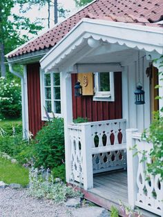 fine little white wood porch for a red house