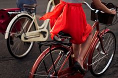 with red skirt on the bicycle