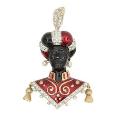 Butler Wilson London Enamel Blackamoor Brooch Pin   From a unique collection of vintage brooches at https://www.1stdibs.com/jewelry/brooches/brooches/