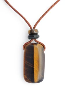 One of a kind, hand carved pendant of Tiger's Eye from South Africa with Hawk's Eye and Tiger's Eye accent beads on brown cord with adjustable sliding bead and two bead dangles. Length range up to app