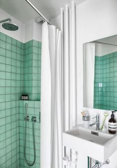 Classic bathroom with a twist - aqua green tiles in the shower transforms a regular bathroom to be fun and creative.