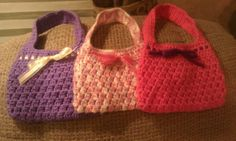 ~ Crochet Bubble Gum Purse ~  I made these as 2012 Christmas gifts. The little girls loved them.   Yarn Used ~ Caron Simply Soft for the solid ones. Peaches N Cream Brand for the multi.  Pattern Link ~  http://speckless.wordpress.com/2010/11/19/free-crochet-pattern-bobble-licious-bag/
