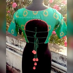 Blouse of the day. Beautiful green color designer blouse with pot design pink color unique design tassels. Saree Blouse Neck Designs, Fancy Blouse Designs, Designer Blouse Patterns, Blouse Models, 3d Max, Blouse Styles, Sumo, Pink Color, Sarees