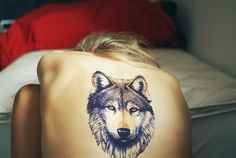 Large, shaded wolf tattoo on the upper/middle back. A true work of art.this!! I want this!! :O only.. I want him to be a lion.. Yes.
