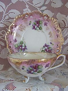 I LOVE vintage teacups with little feet on the bottom....(Also, I just love the cutout work on the plate,on this set)