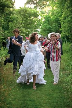 Miranda Brooks at her wedding with the couple being serenaded by the Gypsy band Romashka.  Photo by Joshua Bright.  Vogue, August 2010.