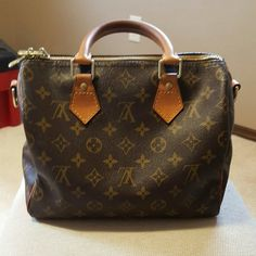 Louis Vuitton Speedy bandouliere 25 Gorgeous speedy 25 in monogram, 100% authetic and in good condition. Pantina is a gorgeous honey color and comes with the dust bag. It does have initals hot stamped on the bag. I can post more pictures of needed :) price is negotiable. No trades, I am selling my bags because I want to take vacation :) Louis Vuitton Bags Crossbody Bags