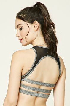 A marled knit high-impact athletic bra featuring a mesh-paneled design with caged cutout back, removable cups, and moisture management.