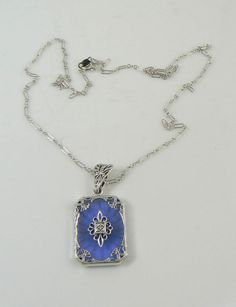 Art Deco Blue Camphor Glass Filigree Diamond Sterling Silver Necklace – Vintage Lane Jewelry - sold $230 . Blue camphor glass is said to be rare. Very nice!
