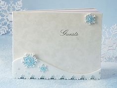 Winter Wonderland guest book from the exclusive Winter Wonderland Collection. An elegant wedding reception guest book featuring a hard cover guest book with a sculpted resin base with embossed snowflakes accented with wintery blue and white colors and perfectly placed crystals. This is the perfect compliment for your winter themed event. Each set comes individually gift boxed and measures 8 x 10.