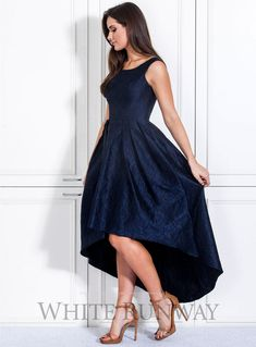Adina Dress. A gorgeous midi length dress by Lounge. A navy floral lace dress with a hi-lo pleated skirt and wide shoulder sleeves.