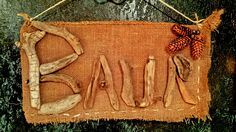 "Driftwood name ""Baur"" on burlap"