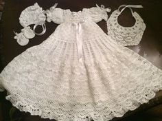A crochet PDF pattern for a very lovely, christening gown, bonnet, bib, and mittens. The pattern has instructions to use no. 10 crochet thread.