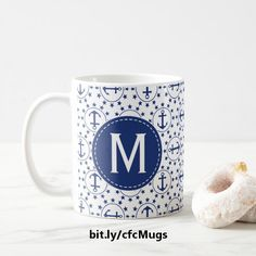 For boating enthusiasts and other maritime buffs, this nautical-themed ceramic mug features a repeating pattern of navy blue anchors inside circles surrounded by stars on top of a white background. Both the front and back of the mug feature a navy blue circle containing a customizable initial. https://www.zazzle.com/z/3snkx&tc=20170222_pint_SSOZ #drinkware #ceramic #monogram #StudioDalio #Zazzle