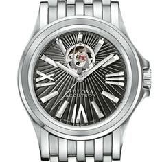 A very bold look from Bulova   The tuning-fork logo displayed over this opening becomes the starting point for the sunburst guilloché motif. With its strong lines and meticulous detail, this distinguished watch offers special appeal to devotees of innovative Swiss design.