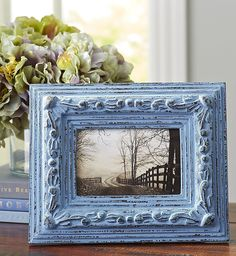 Hand-carved of wood, then hand-painted and gently distressed, Pier 1's Smoke Blue Vintage-Style Frame has an heirloom look that draws attention to Mom's favorite 4x6 photo. What a thoughtful Mother's Day Gift.