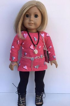 18 Doll Clothing fits American Girl Doll - 7 pc outfit includes long sleeved knit tunic, leggings, necklace, bracelet, belt, purse and sandals. The long sleeved knit tunic closes in back with a strip of thin velcro. It was made from a modified pattern from Pixie Faire. The black