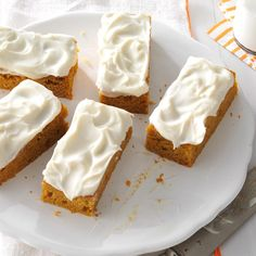 Pumpkin Bars Recipe -What could be more appropriate for a Halloween treat than Pumpkin Bars? Actually, they're a hit with my family anytime of the year. —Brenda Keller, Andalusia, Alabama
