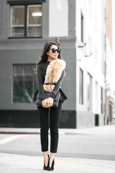Peplum top, slim pants and faux fur stole
