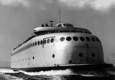 The Kalakala, super-futuristic ferry for the Seattle area, then left abandoned on Kodiak, AK until 1998.