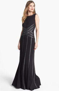 Beautiful! Tadashi Shoji Foil Print Detail Jersey Gown at Nordstrom.com. A silvery foil-print veneer highlights the textured basket-weave bands encircling the neckline and crisscrossing the bodice of a statuesque jersey gown before streaming down the floor-sweeping skirt.
